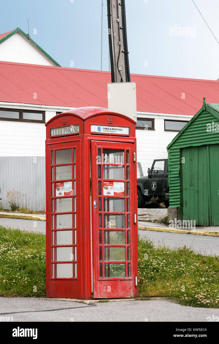 A typical older style red British Phone Booth. Phonebooth,  Port Stanley, Falkland Islands. - Stock Image