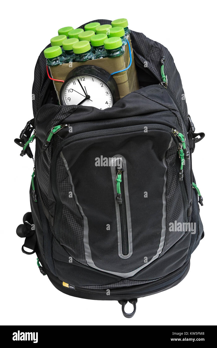 Bomb in the backpack. Terrorist attack. Dangerous timebomb in bag on white background. Isolated. - Stock Image