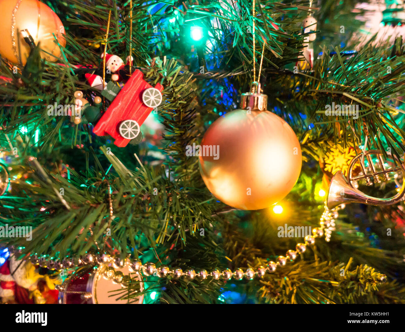 a-close-up-of-a-christmas-tree-decorated-with-baubles-and-colourful-KW5HH1.jpg