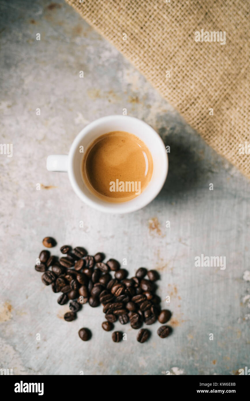 Fresh espresso on old metal surface - Stock Image