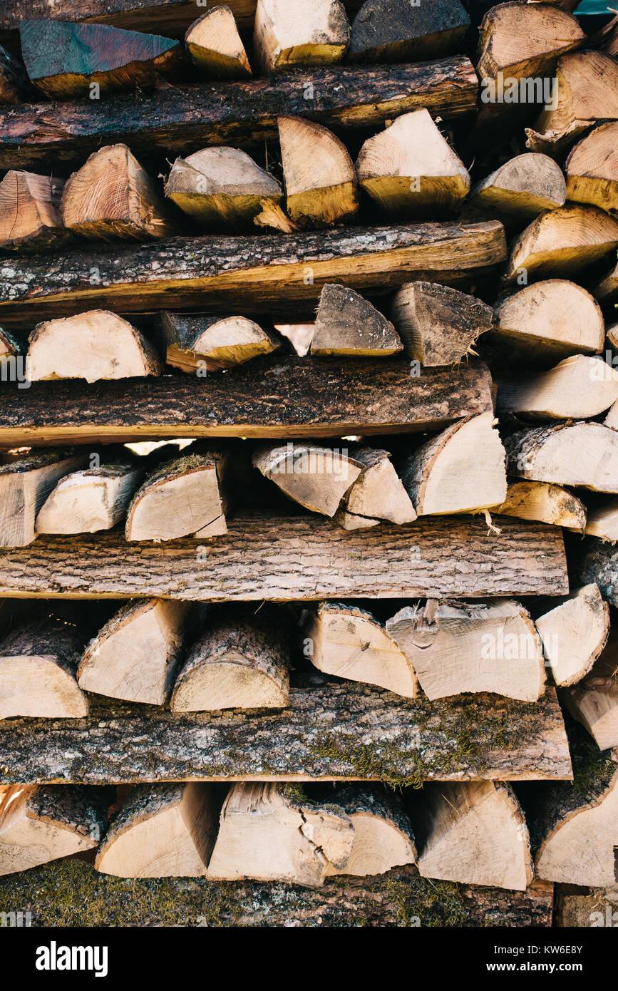 Stacked firewood background - Stock Image