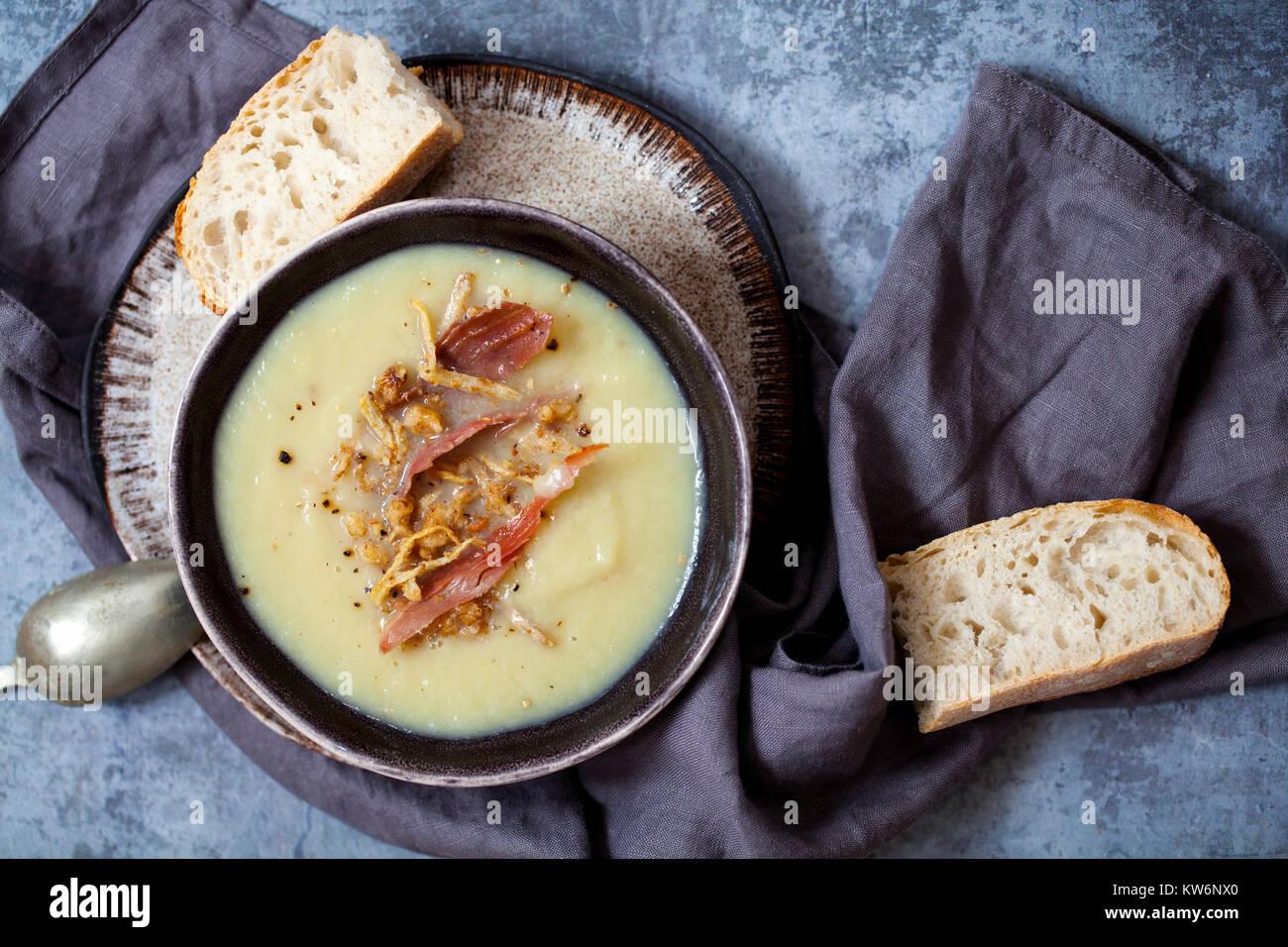 Jerusalem artichoke soup with walnut, ginger and parma ham crumb - Stock Image