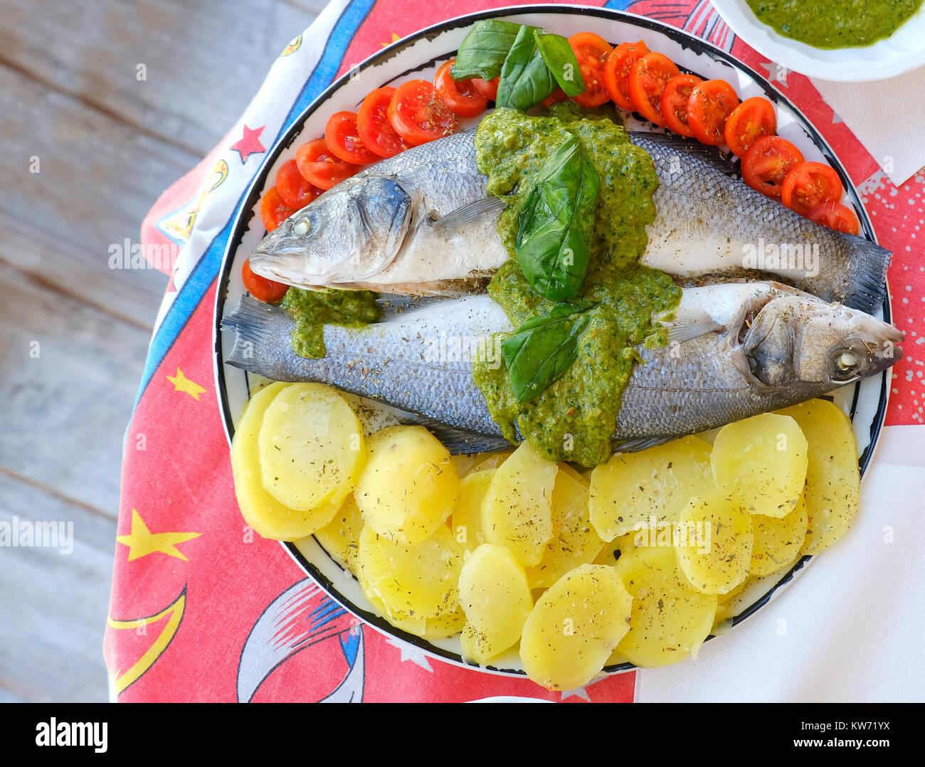 european sea bass branzino steaming basil sauce recipe high angle up view - Stock Image