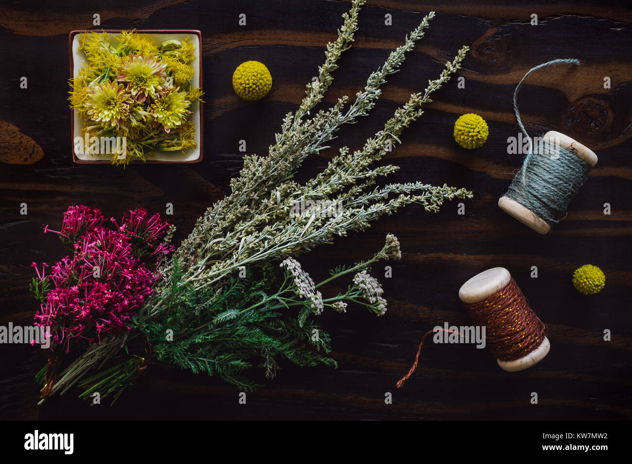 Bouquets of Yarrow, Sage and Native Flora with String - Stock Image