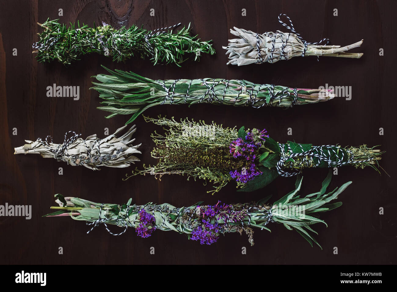 Fresh Herb Bundles of Rosemary, Sage and Flowers - Stock Image