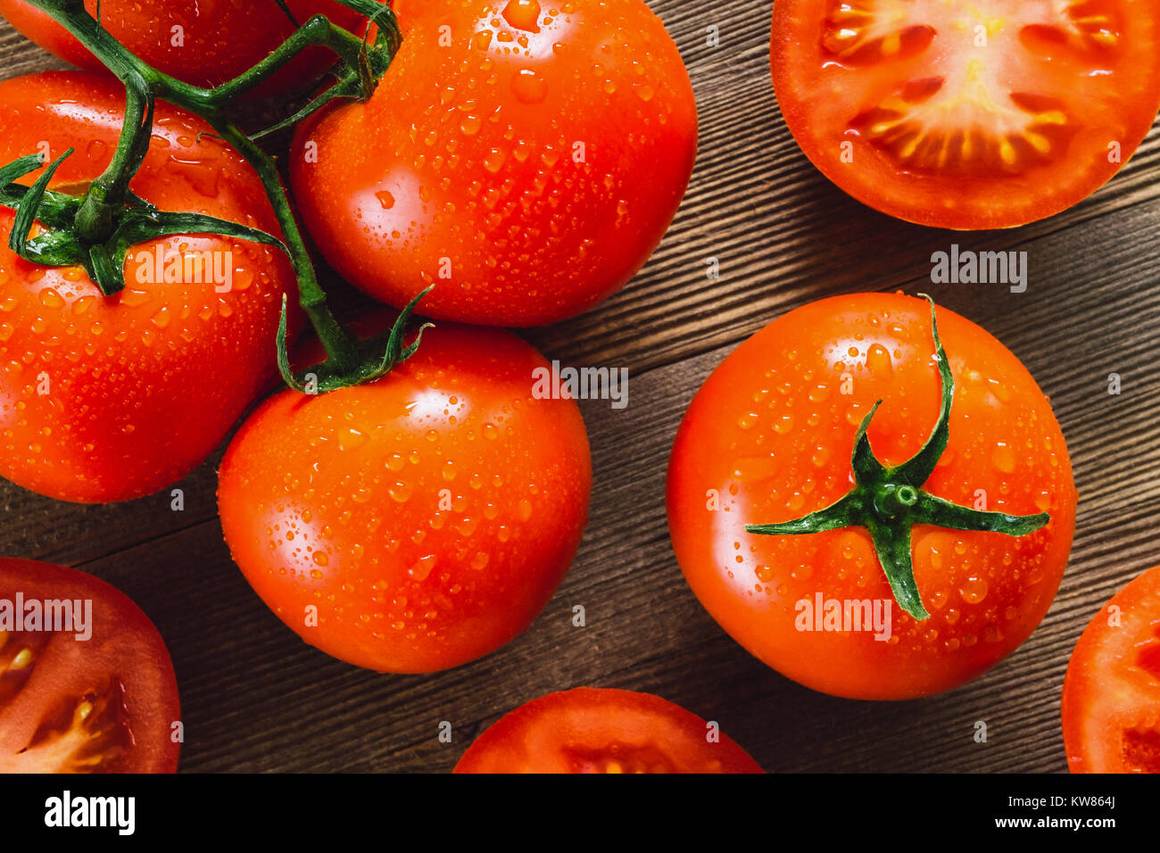 Freshly Washed Tomatoes on Cedar Table - Stock Image