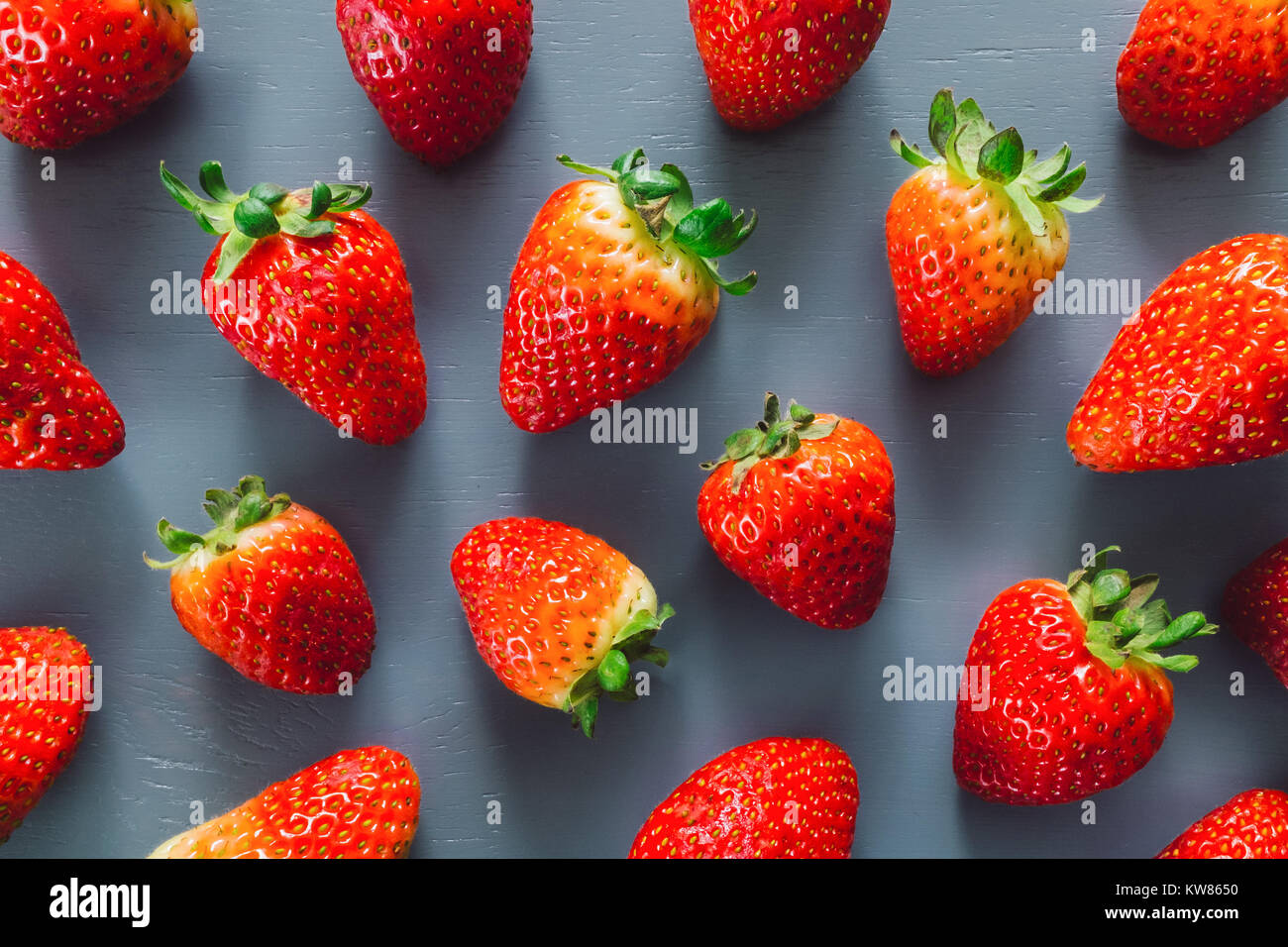 Fresh Strawberries on Blue Table - Stock Image