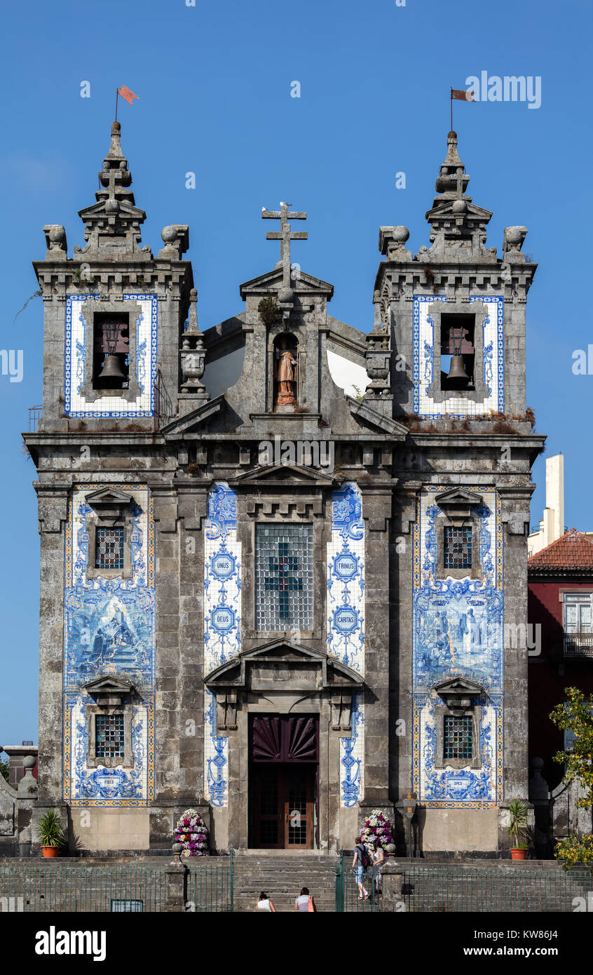 Facade of the 18th century church of Saint Ildefonso in Porto, Portugal, built in a proto-Baroque style, named in - Stock Image