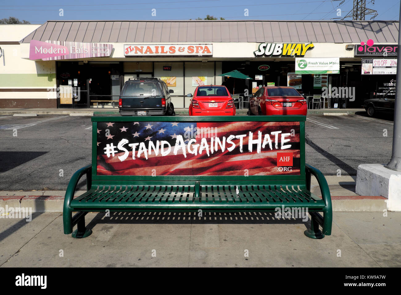 AIDS Healthcare Foundation  #STAND AGAINST HATE campaign advert with American flag on a bench in Silver Lake, Los - Stock Image
