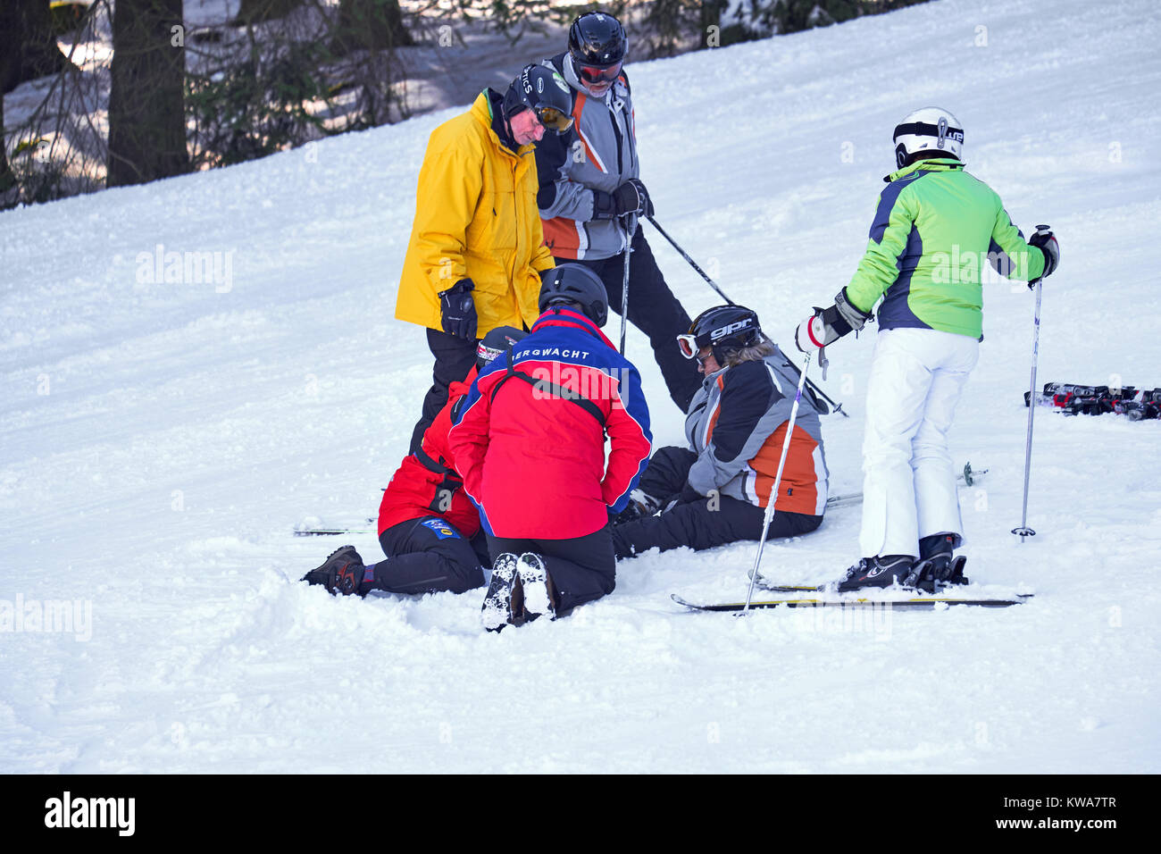 WINTERBERG, GERMANY - FEBRUARY 15, 2017: Rescue team taking care of a woman on a piste at Ski Carousel Winterberg - Stock Image