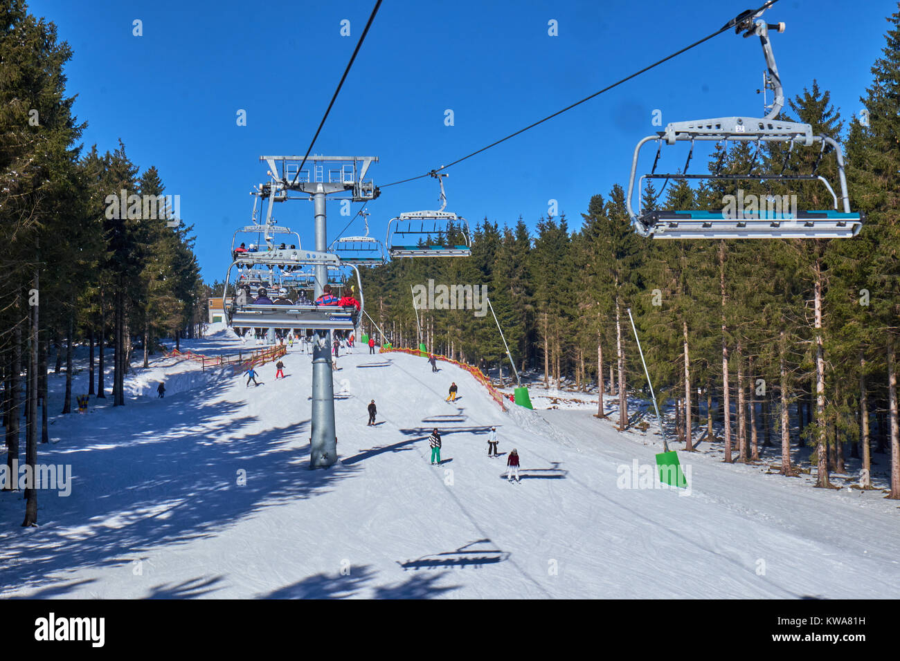 WINTERBERG, GERMANY - FEBRUARY 14, 2017: People on skis seen from up high in a chairlift at Ski Carousel Winterberg - Stock Image