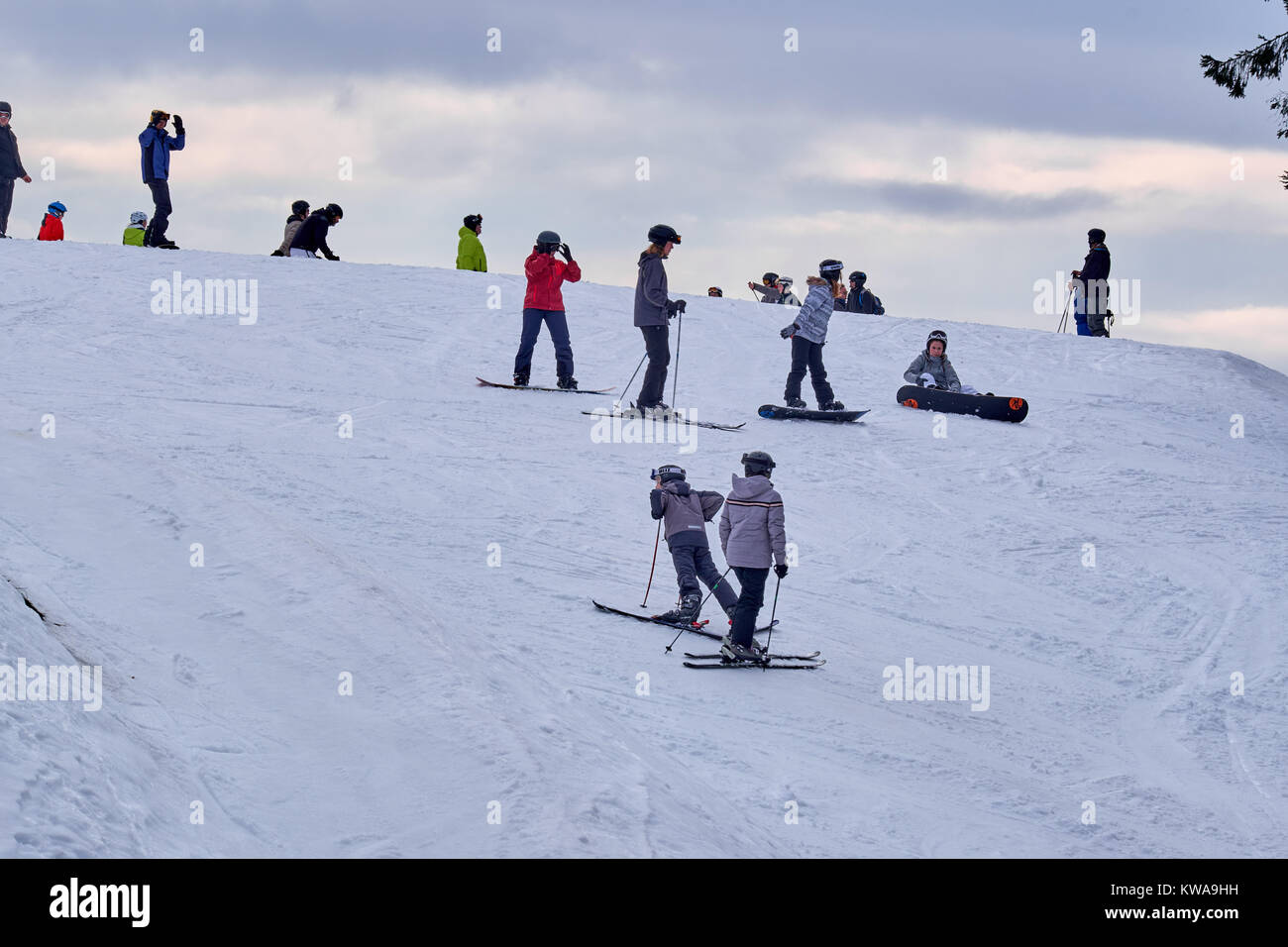 WINTERBERG, GERMANY - FEBRUARY 16, 2017: Many people on skis and snowboards on a mountain top at Ski Carousel Winterberg - Stock Image