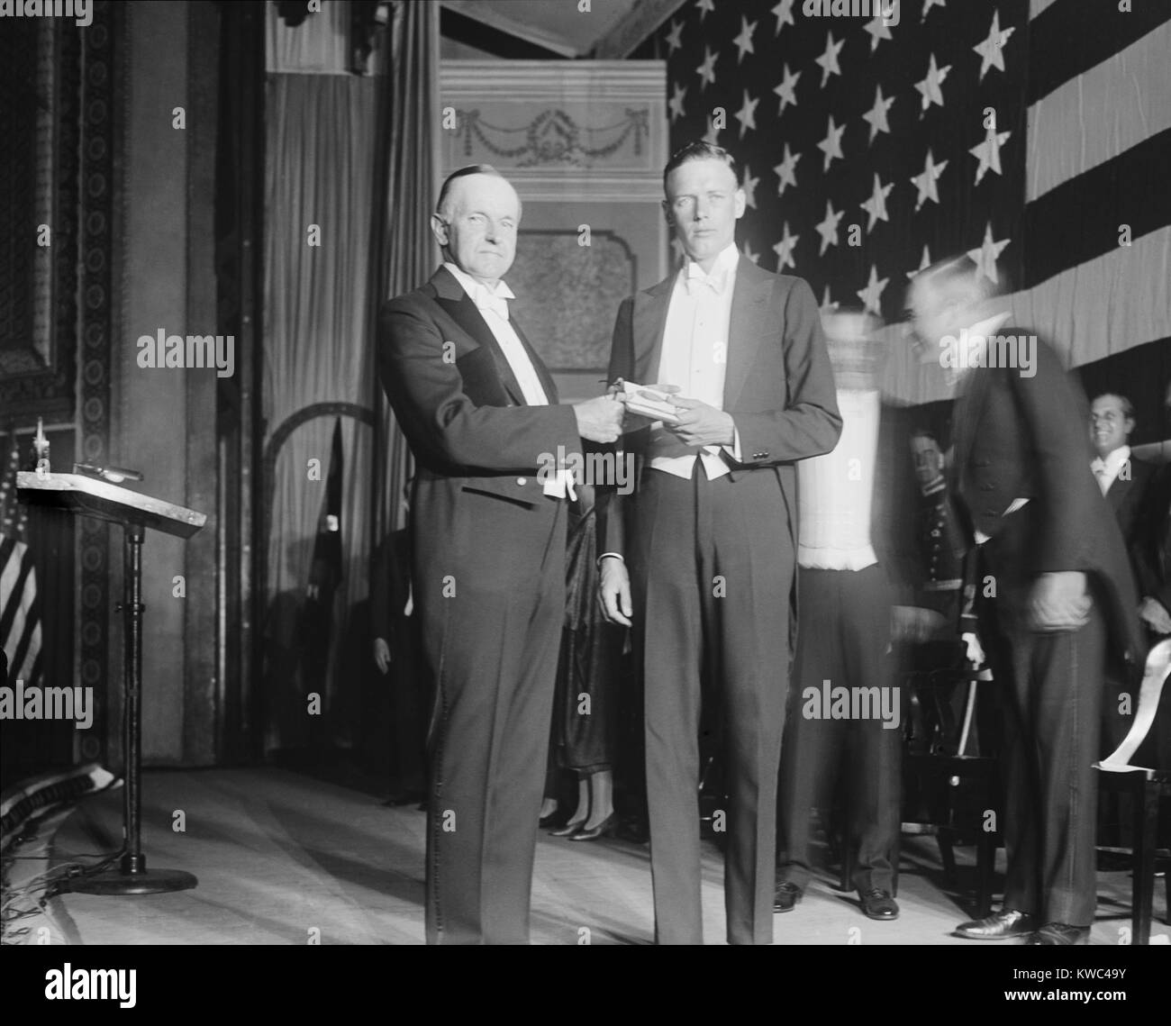 President Calvin Coolidge presents Charles Lindbergh with Congressional Medal of Honor. Nov. 1927. Lindbergh was - Stock Image