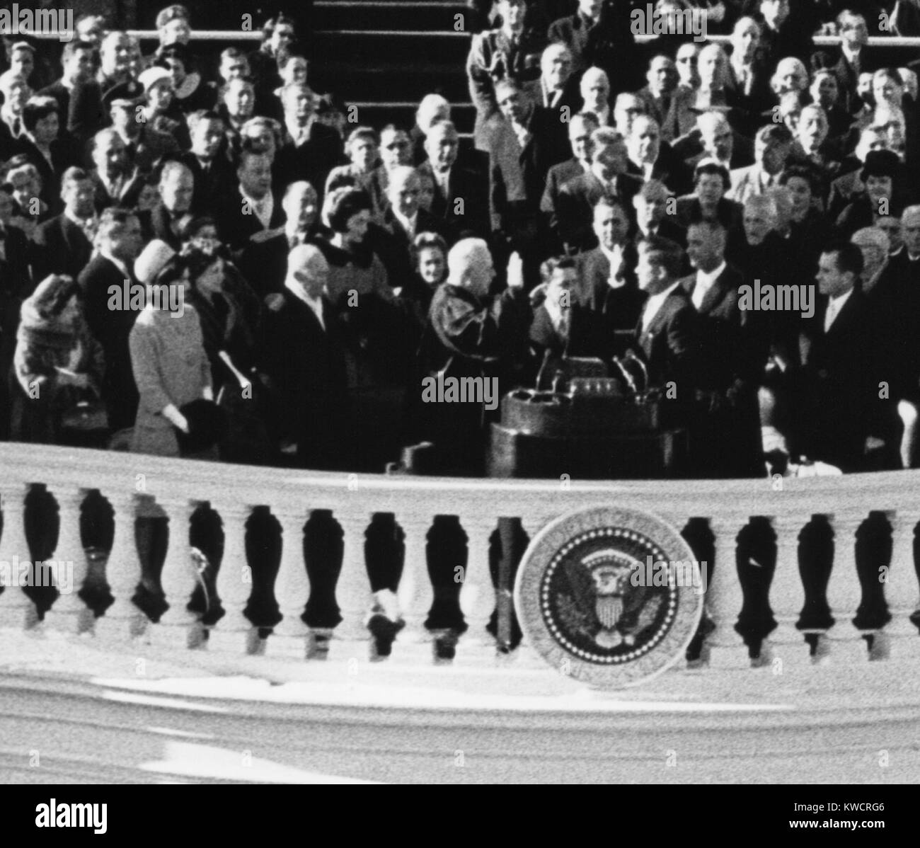 President John Kennedy takes the oath of office administered by Chief Justice Earl Warren. Jan. 20, 1961. - (BSLOC - Stock Image