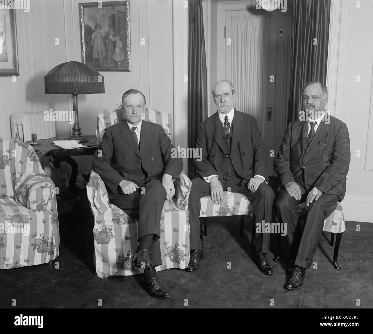 President Calvin Coolidge meeting with Charles Evans Hughes and Charles Curtis, August 3, 1923. Coolidge became - Stock Image