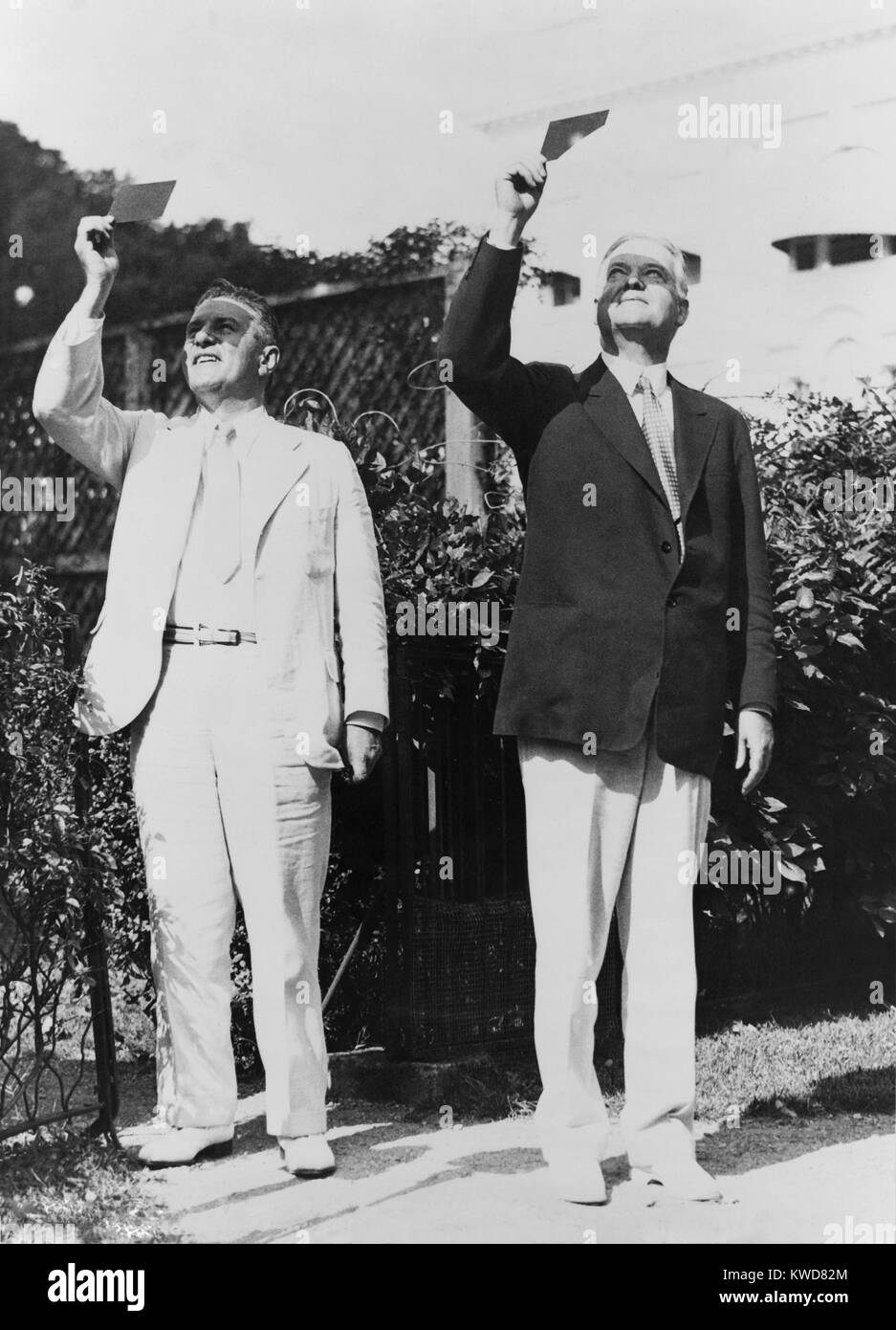 President Herbert Hoover and Lawrence Richey watching a solar eclipse through smoked glass. Aug. 31, 1932. Richey - Stock Image