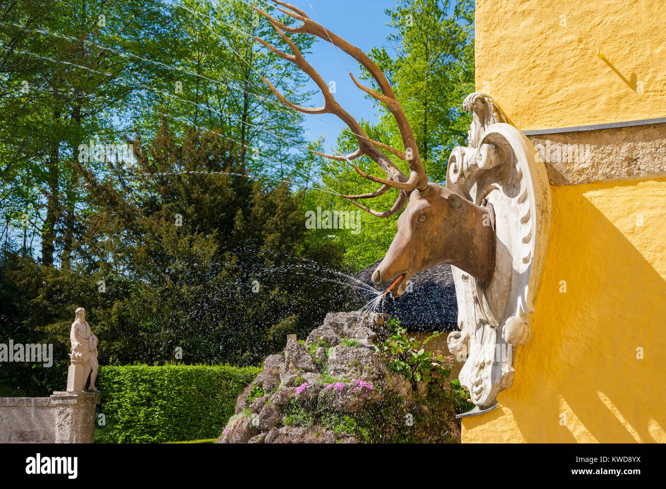 A deer head trick fountain in the Jeux d'eau of Hellbrunn Palace in Salzburg, Austria. - Stock Image