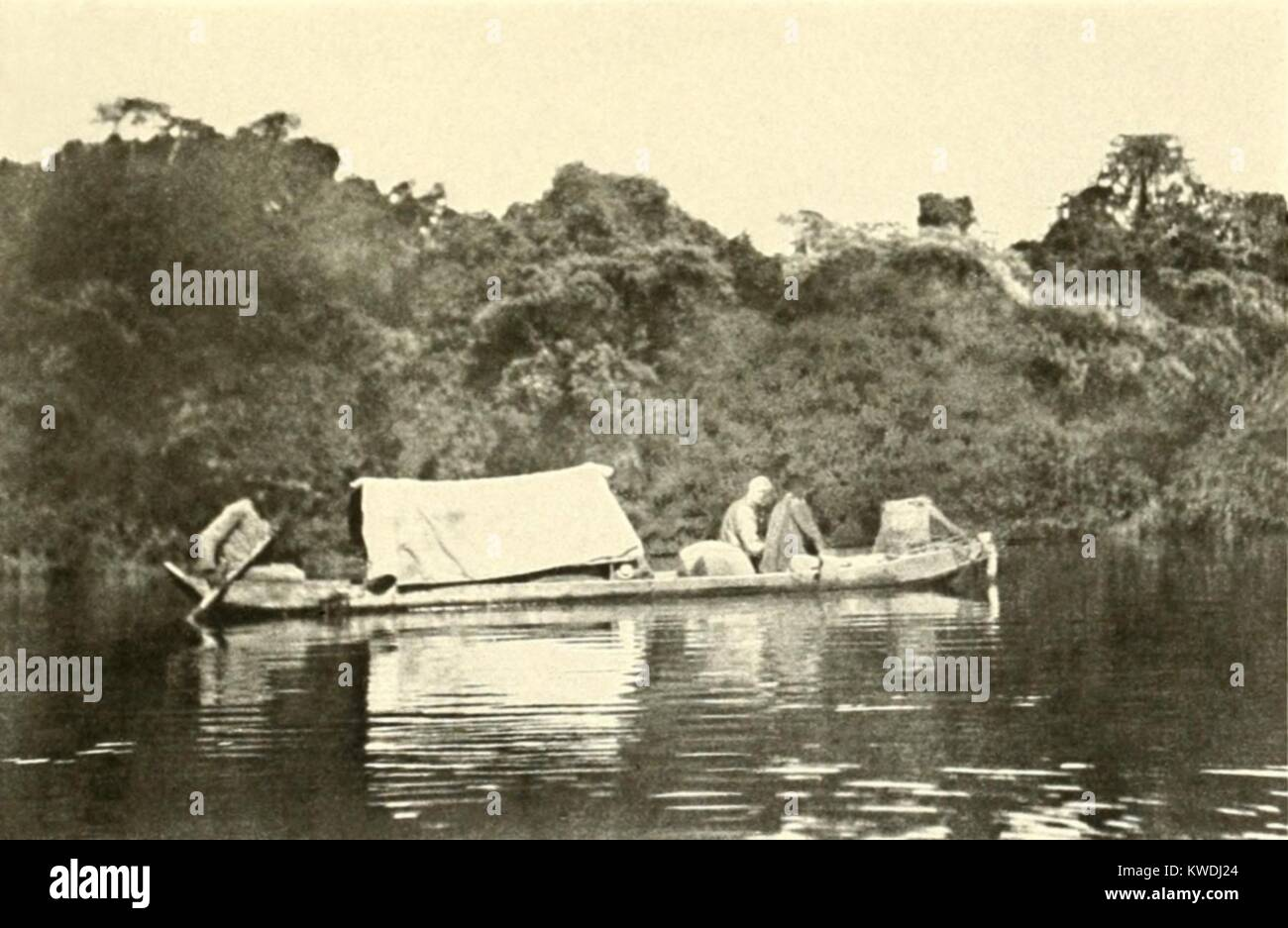 Canoe rigged with a cover under which sick Colonel Roosevelt travelled. At the end of the Roosevelt-Rondon Expedition, - Stock Image