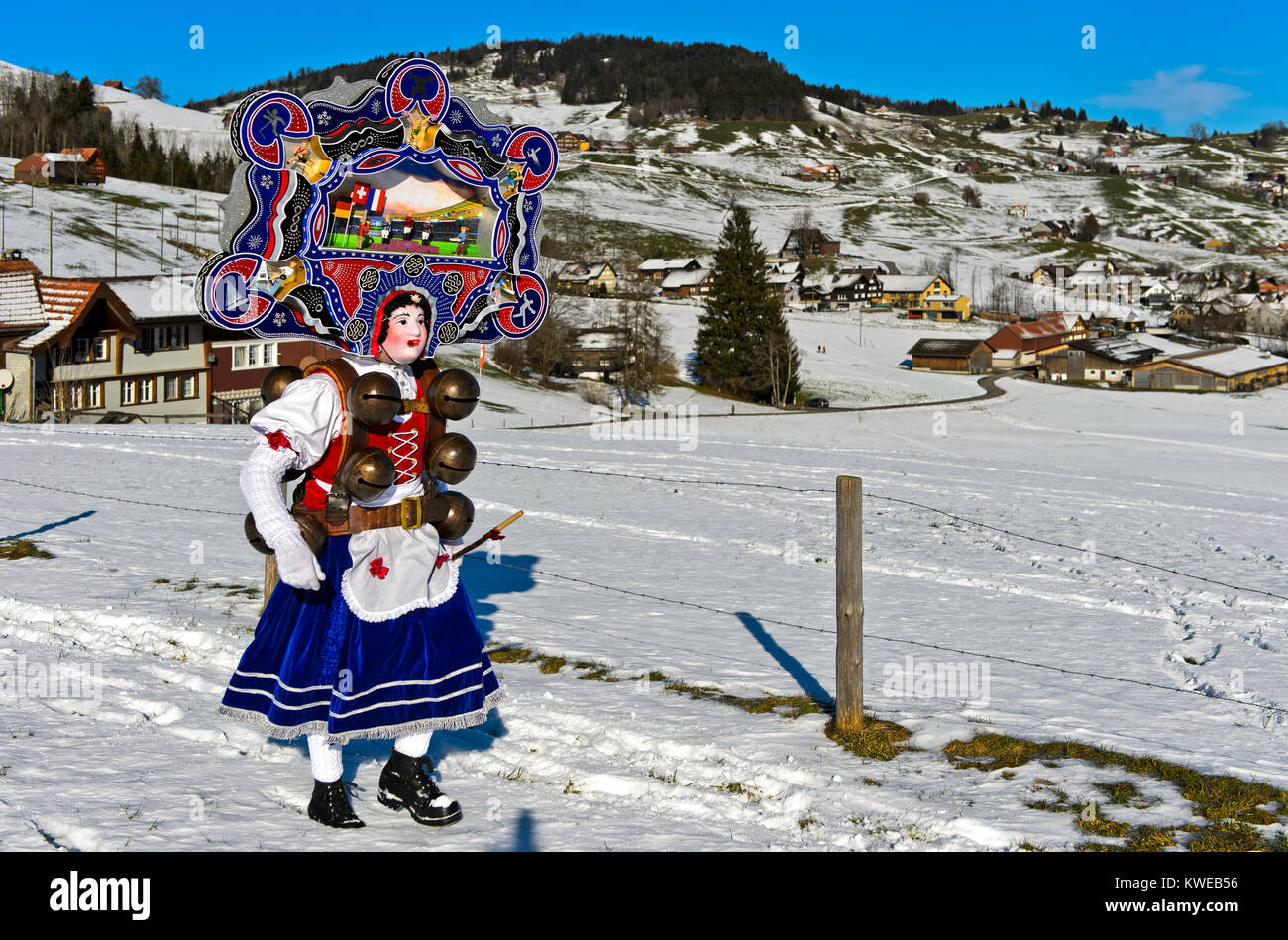 A Beautiful Chlaus with ornate embroidered headgear, Urnäsch St Sylvester mummers, at Old Sylvester, Urnäsch, - Stock Image