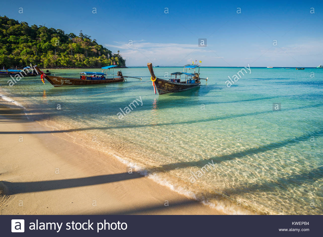 long-tail-boats-and-the-shadow-of-palm-t