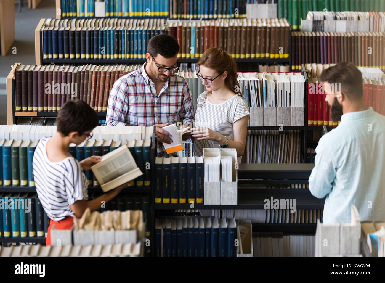 Group of college students studying - Stock Image