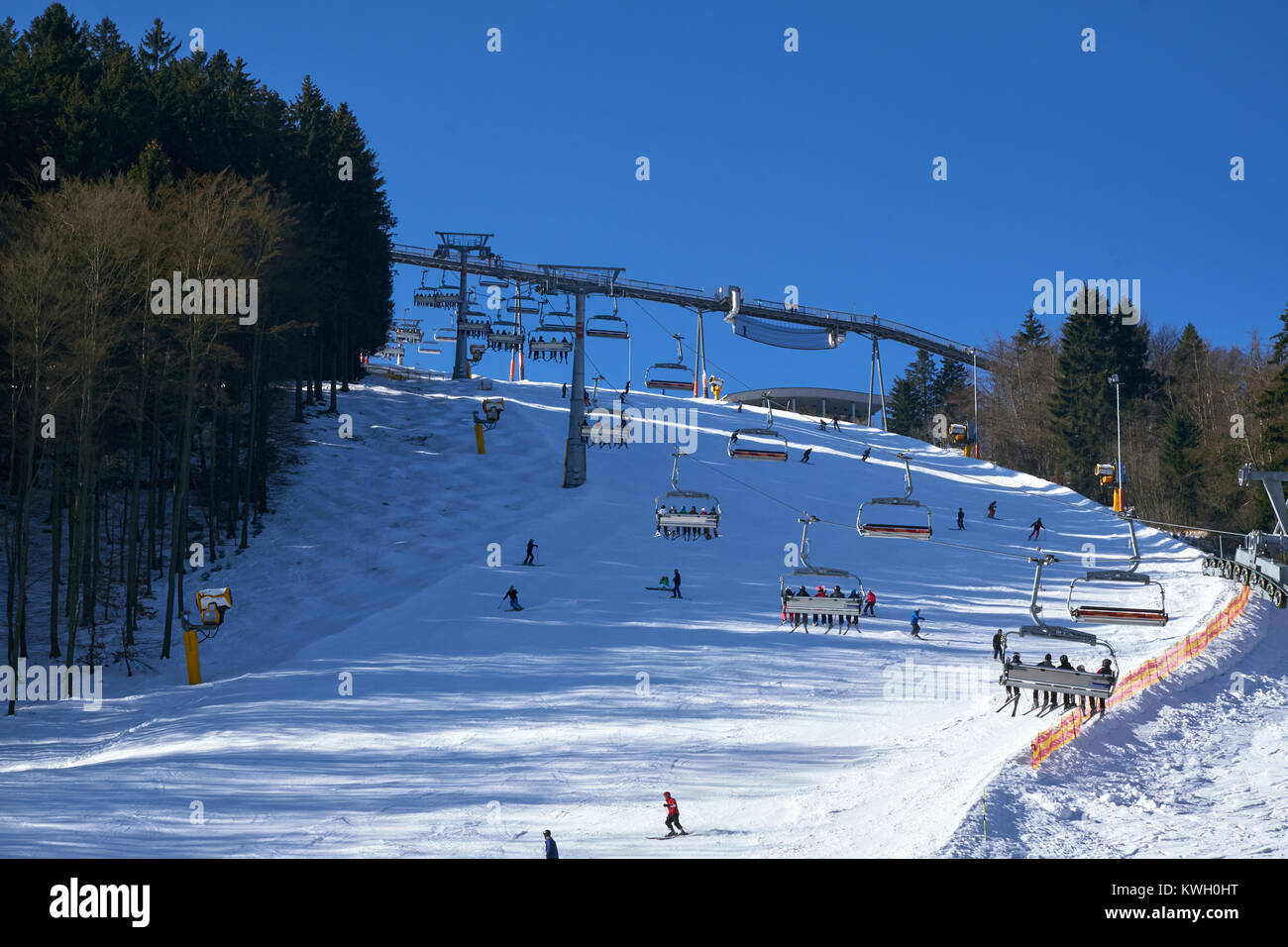 WINTERBERG, GERMANY - FEBRUARY 15, 2017: Six seater chairlift over a piste at Ski Carousel Winterberg - Stock Image