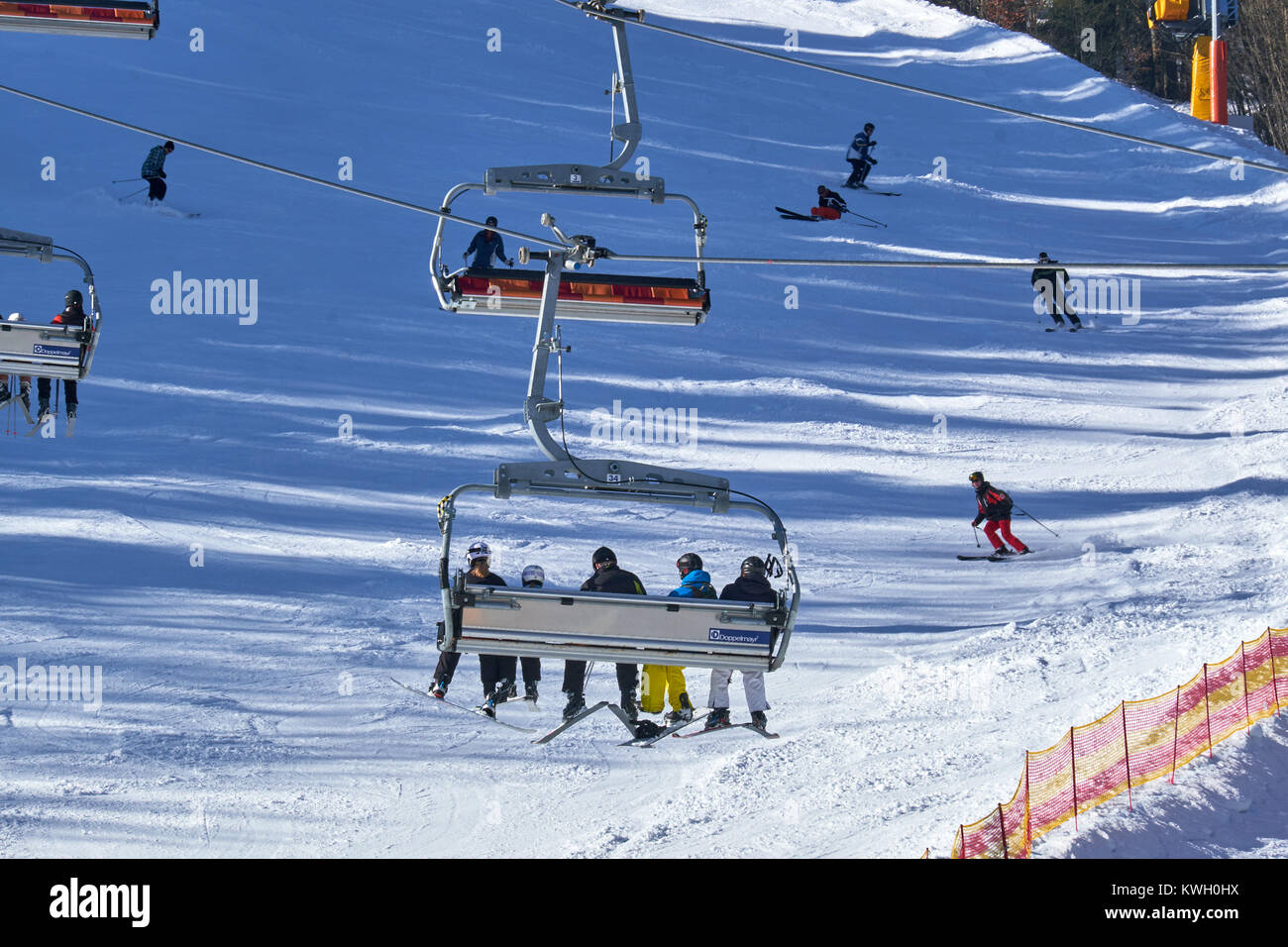 WINTERBERG, GERMANY - FEBRUARY 15, 2017: People having fun on a ski piste at Ski Carousel Winterberg - Stock Image