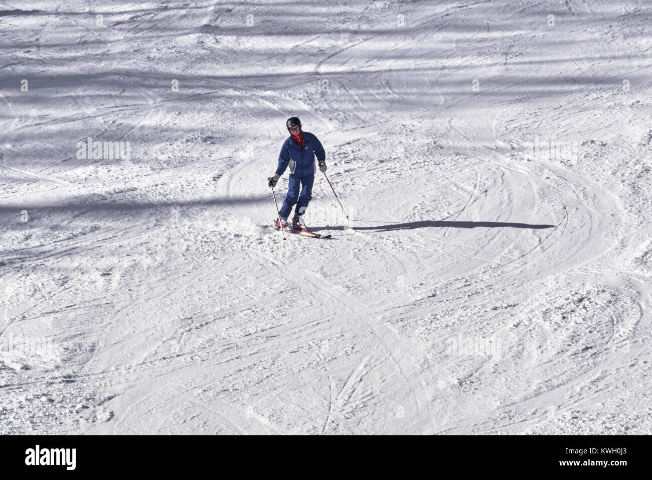 WINTERBERG, GERMANY - FEBRUARY 15, 2017:  Old man in swaying style on downhill piste Ski Carousel Winterberg - Stock Image