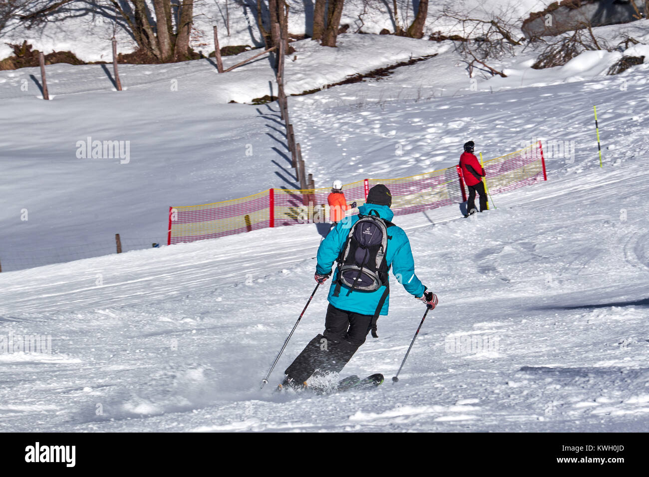 WINTERBERG, GERMANY - FEBRUARY 15, 2017: Man standing downhill  with parallel skies at Ski Carousel Winterberg - Stock Image