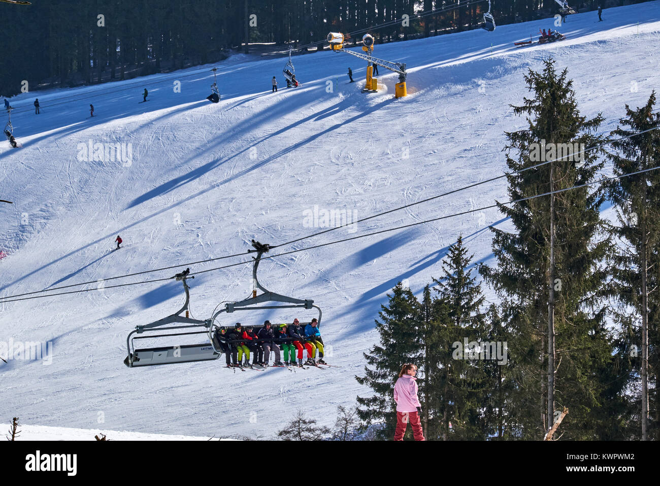 WINTERBERG, GERMANY - FEBRUARY 15, 2017: Chairlift hanging over a ski piste at Ski Carousel Winterberg - Stock Image