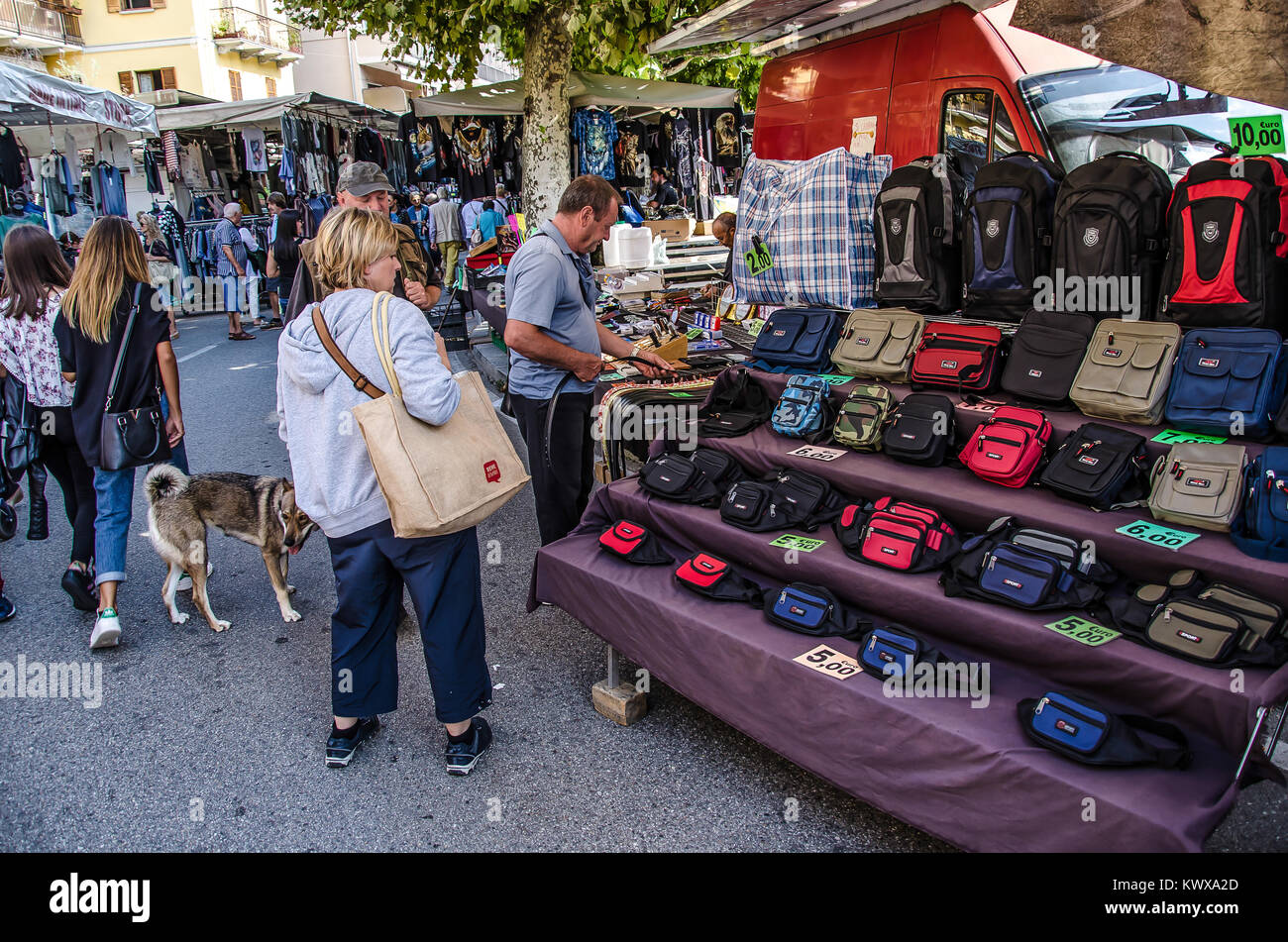 Street markets, sounds and smells, local products, handcrafts - all this and more awaits you in the typical local - Stock Image