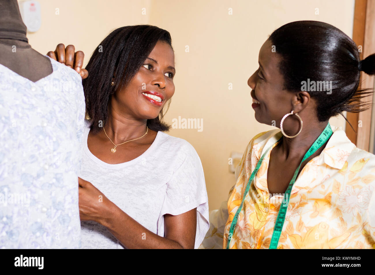 Two happy seamstresses work in perfect harmony in their workshop. - Stock Image