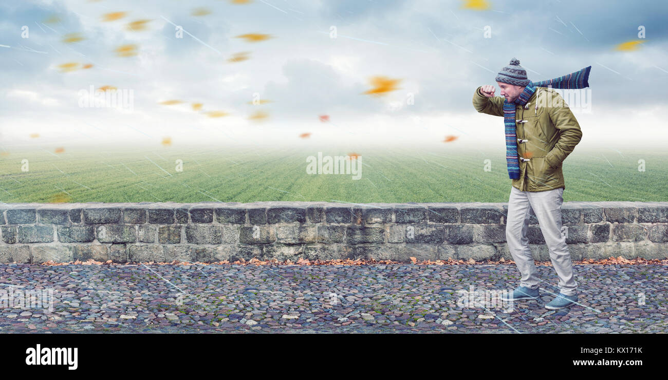 Man faces headwind - Stock Image