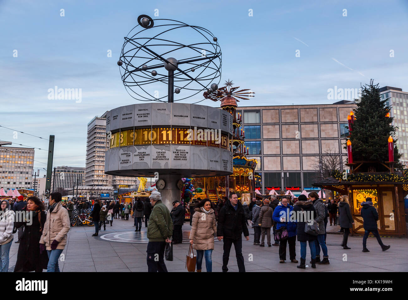 Several tourists are standing under the World Time Clock in Alexanderplatz in Berlin - Stock Image