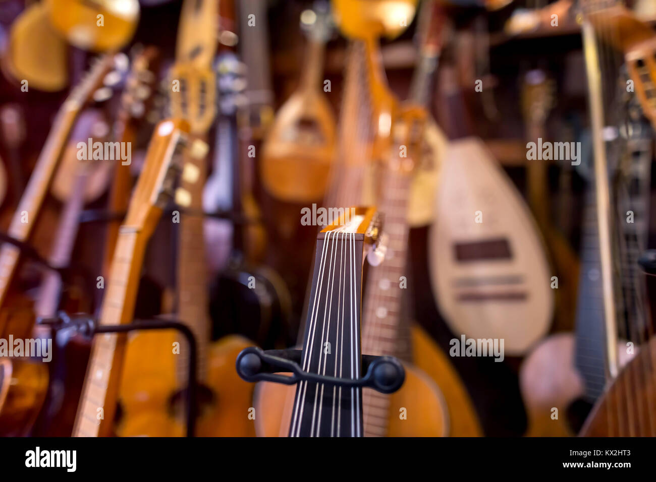 musical instruments shop with blurred background - Stock Image