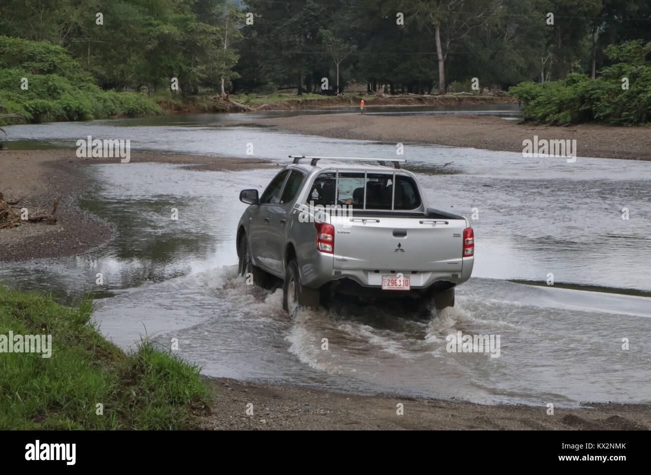 Car crossing river near Drake Bay Costa Rica Osa Peninsula - Stock Image