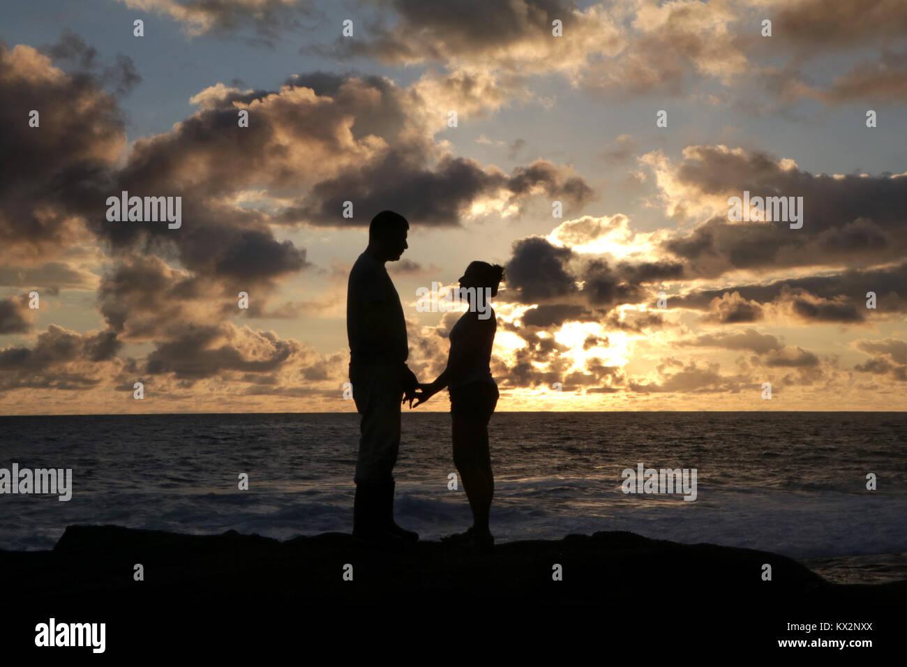 Couple on beach at sunset Costa Rica Pacific coast, the Osa Peninsula - Stock Image