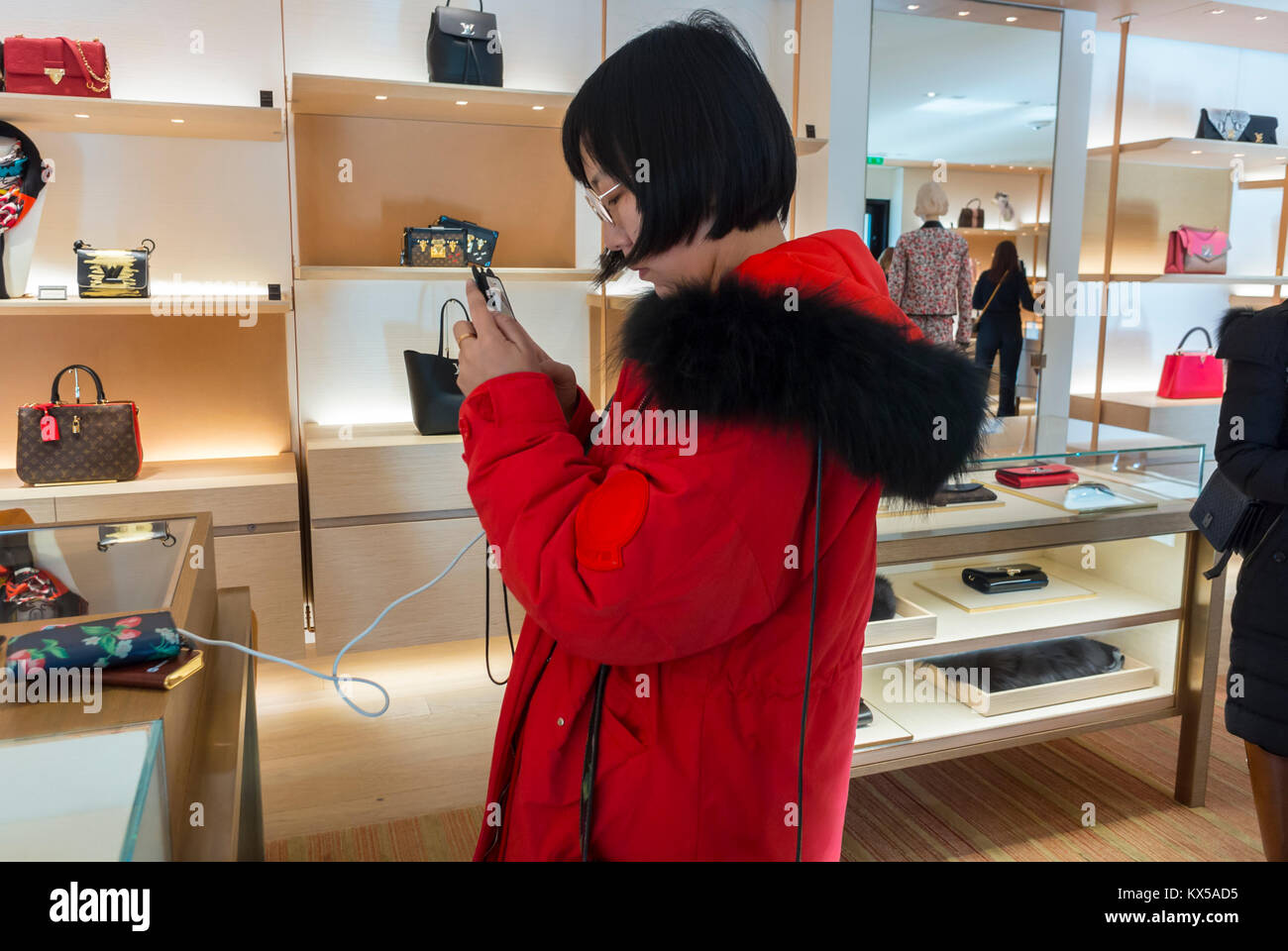 Nice, France, Chinese Tourists, Shopping, Louis Vuitton LVMH luxury CLothing Store - Stock Image