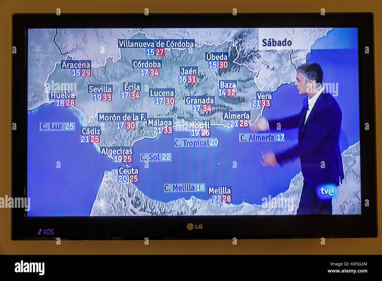 Porto Portugal television screen tv monitor flat panel program weather report meteorologist southern Spain temperatures - Stock Image