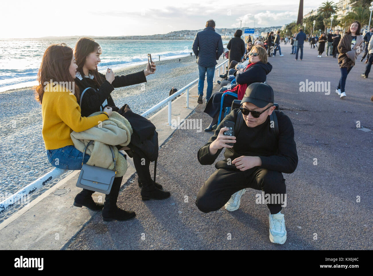 Nice, France, Tourists visiting Promenade des Anglais, Near Mediterranean Sea Beach - Stock Image
