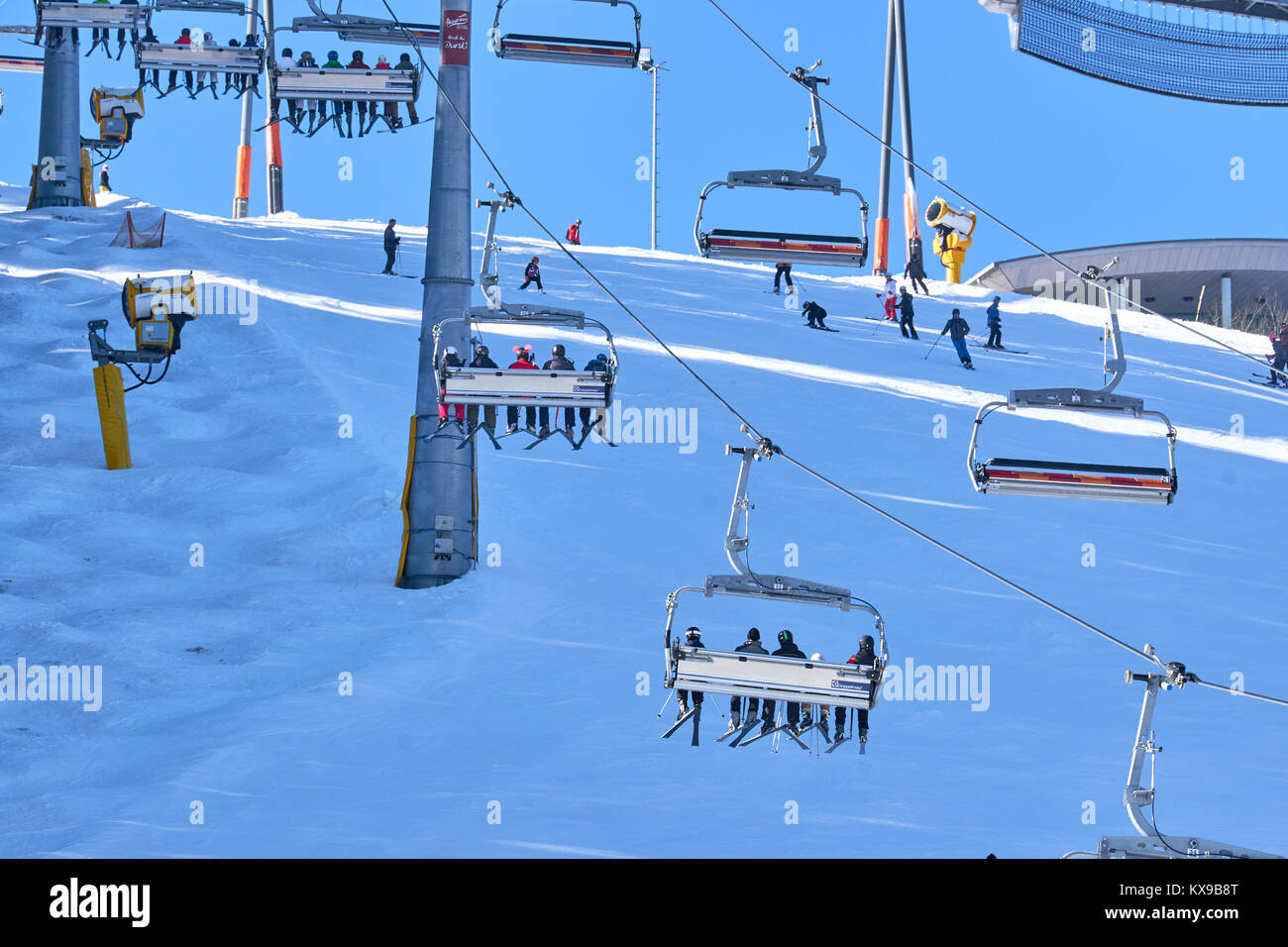 WINTERBERG, GERMANY - FEBRUARY 15, 2017: People in chairlifts transported to a top at Ski Carousel Winterberg - Stock Image