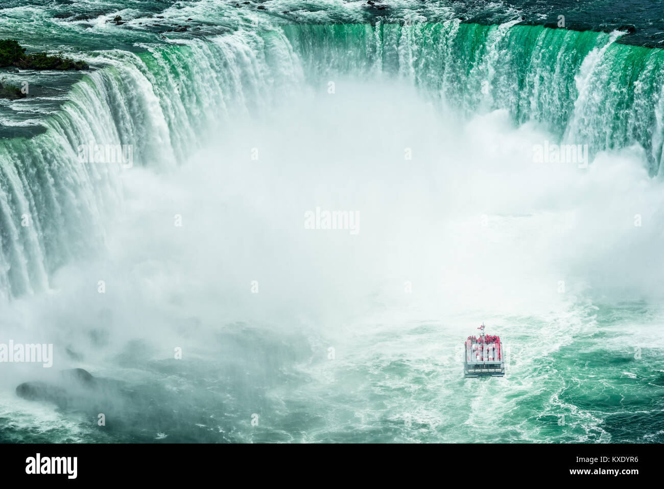 High Angle view on Passenger Ship approaching the Niagara Falls, seen from Canadian side - Stock Image