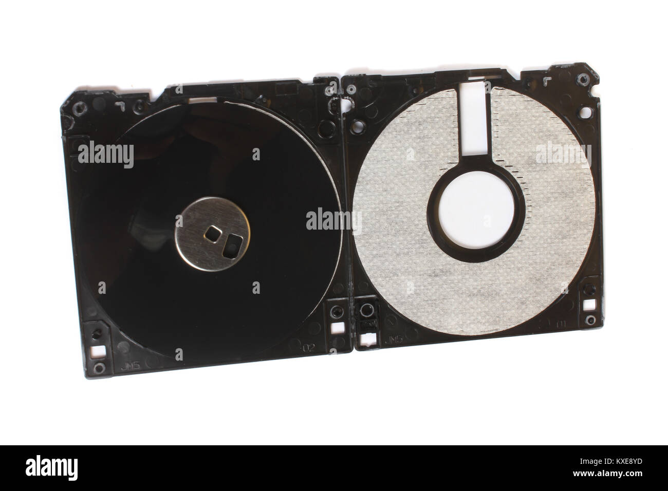 An old floppy used for storing data stripped down showing its magnetic disc. - Stock Image