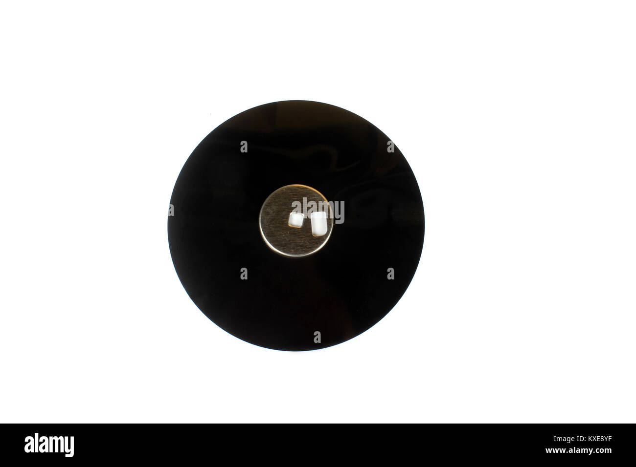 The round magnetic disk inside a floppy disc used to store data before. - Stock Image