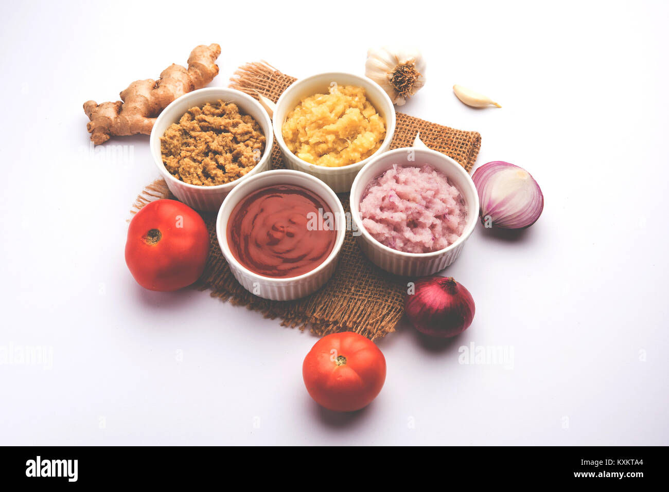 Ginger,  Garlic, onion and tomato paste or Sauce. Basic Indian food ingredients. Selective focus - Stock Image