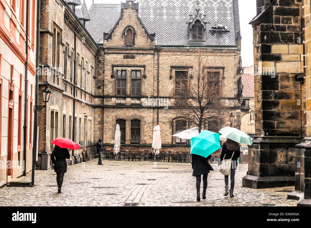 rainy day in the historic center of prague strollers with umbrellas cobbled streets and historical buildings czech - Stock Image