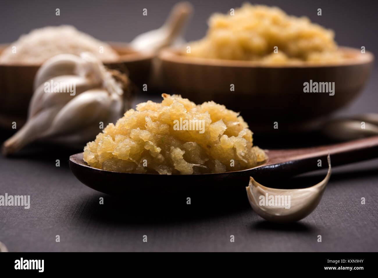 dried granulated garlic powder and garlic paste, selective focus - Stock Image