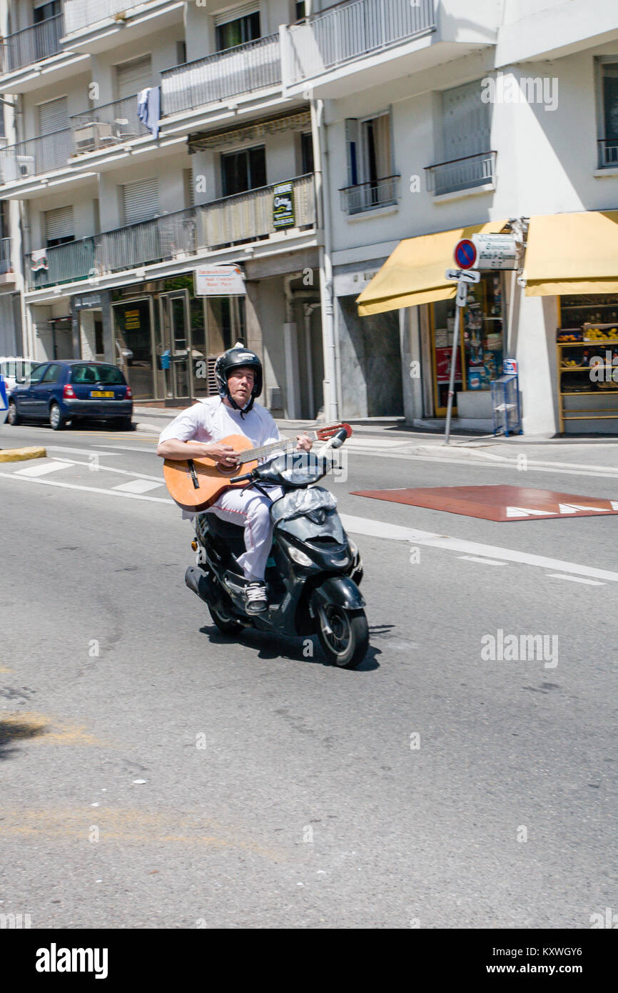 man-riding-motor-scooter-down-the-hill-a