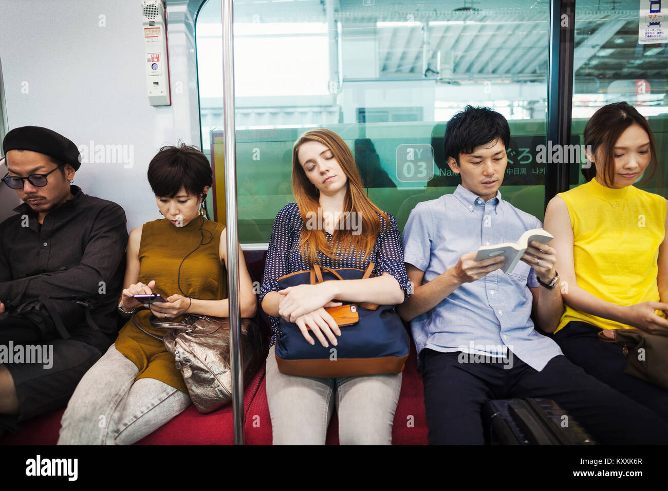 People Reading On Subway Stock Photos & People Reading On ...