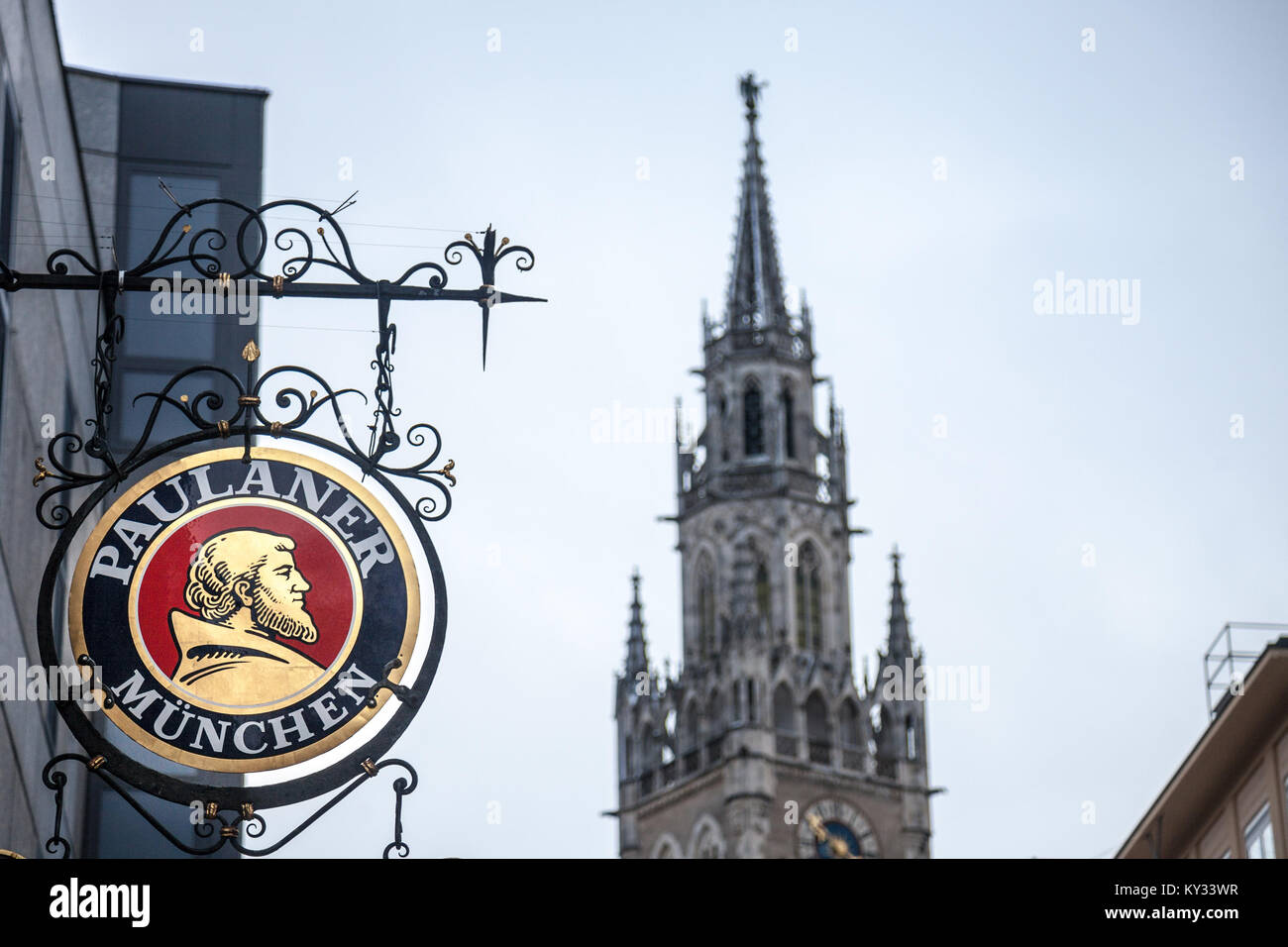 MUNICH, GERMANY - DECEMBER 17, 2017: Paulaner Beer logo in front of Munich New Town Hall (Neues Rathaus). Paulaner - Stock Image